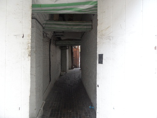 Alongside butcher shop on Market St. Beams are covered in stripy plastic on this photo unfortunately, but every now and again the alley is open for you to go and take a look...