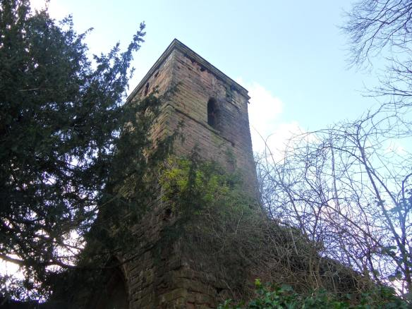 In the churchyard at the top of the hill is an old tower...