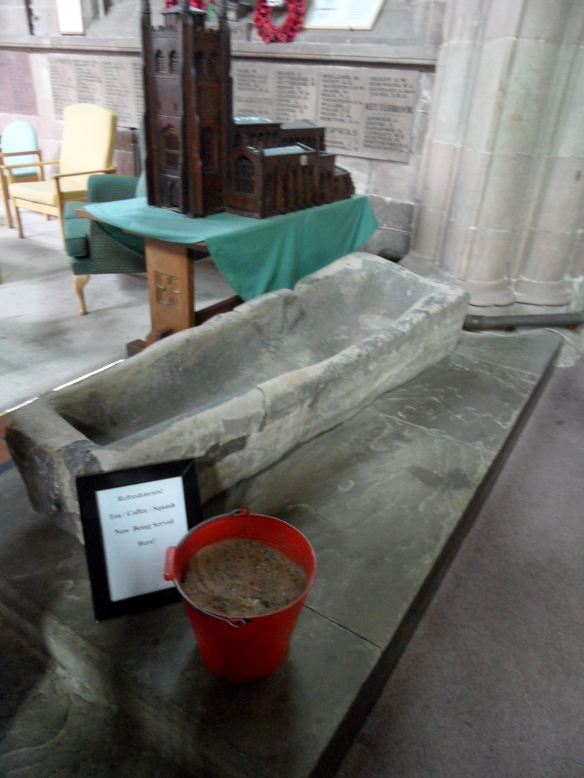 One of the stone coffins can now be found outside the Comberford chapel