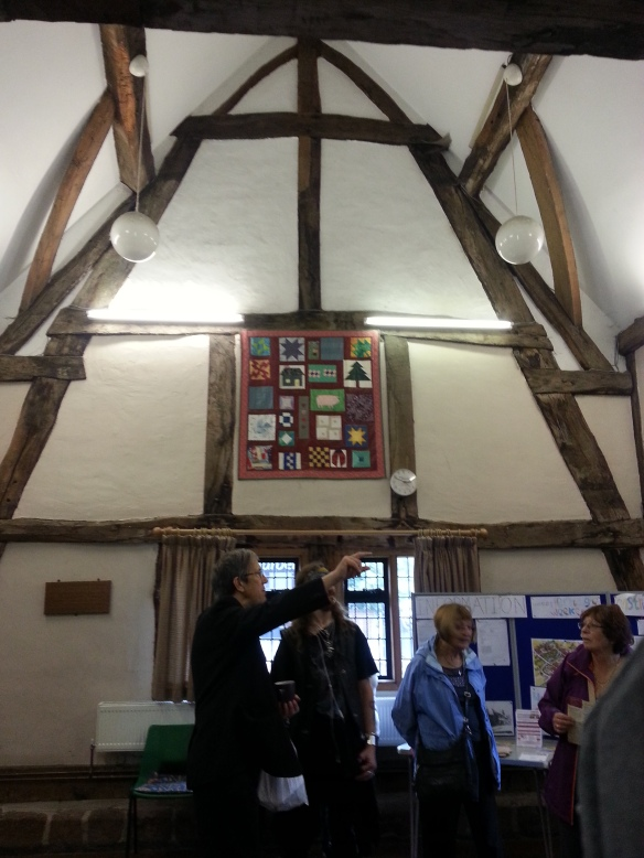Discussing the history of Cruck House with the Friends to Friends group