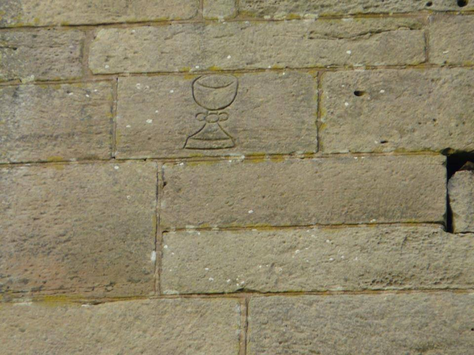 Chalice carving on Gnosall church tower (photo by Kenneth Ingram)