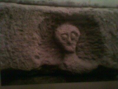 This may represent a skull in a niche a la Roquepertuse or it may be another local god. We just don't know but it is fun speculating.