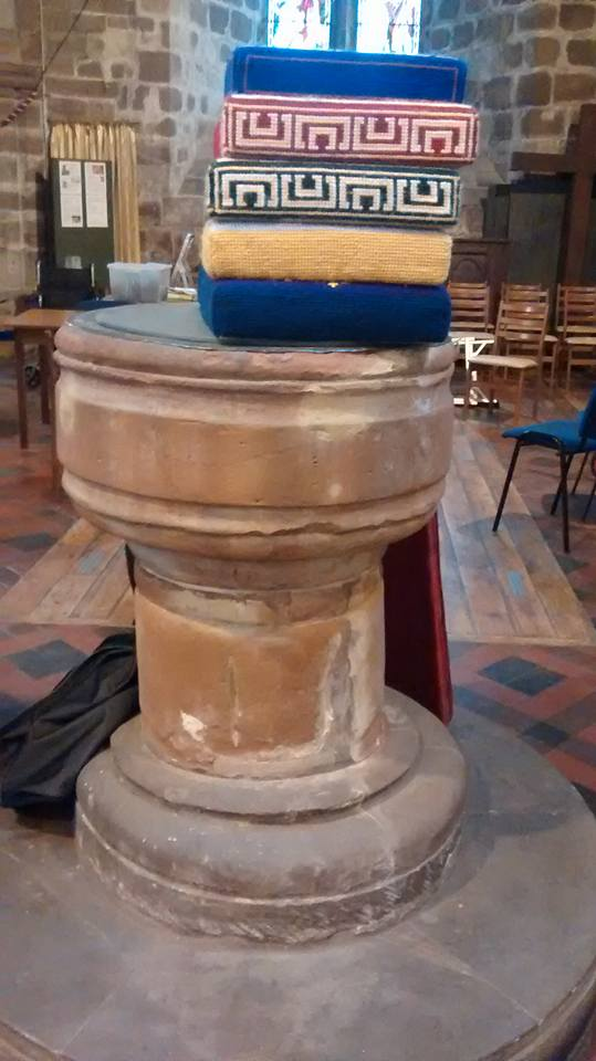 Thirteenth century sandstone font and some plumped up cushions